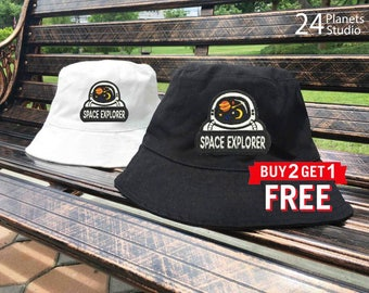 Astronaut Space Explorer Embroidered Bucket Hat by 24PlanetsStudio