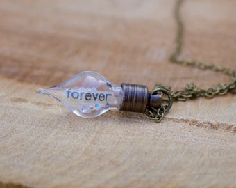 Glass teardrop pendant with floating message 'forever' and crystals