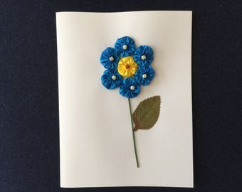 Greeting Card with a Blue Flower Design
