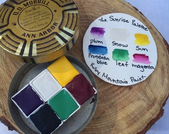 The Sunrise Palette.  A handmade watercolor paint set featuring 6 half pans in a vintage tin