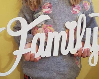 Wooden Family writing with Silhouette