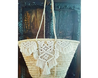 Wicker basket has long handles decorated with macrame