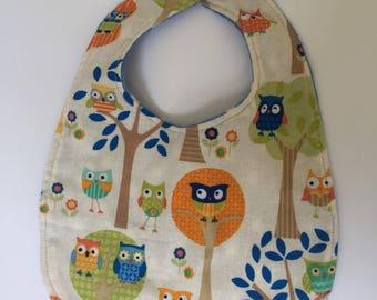Owl print and blue/white spot reversible bib - handmade