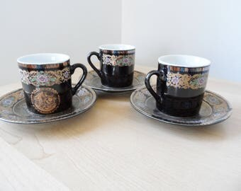 Expresso cups and saucers black with gold victorian theme, made in Japan, set of 3!