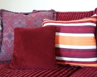 Orange striped pillow end bordeaux