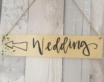 Small wooden hanging signs