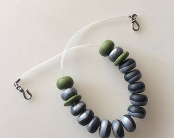 Black necklace, silver and green