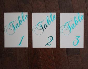 Foil stamped elegant script table numbers