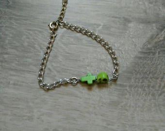 Head and green cross bracelet