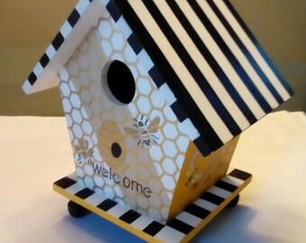 Birdhouse with designer bee motif