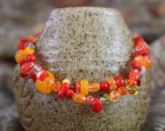 Viking inspired double strand bracelet,orange and multicolored glass,silver plated lobster clasp, accent beads,twisted rings, B155
