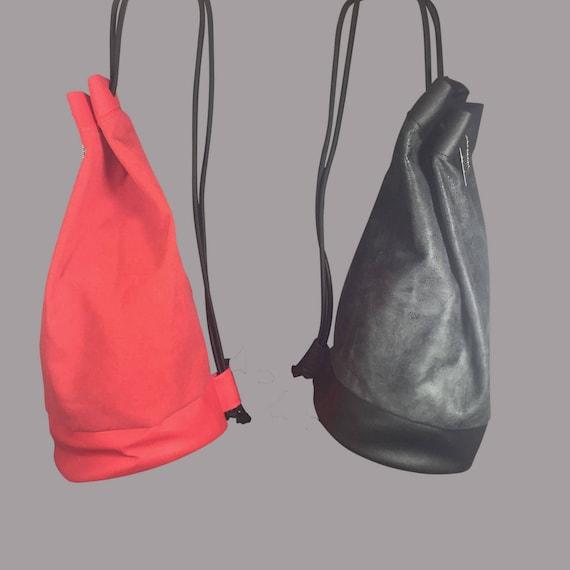 """Designer bag Backpack """"ROUND"""" Kunstleder black or red"""