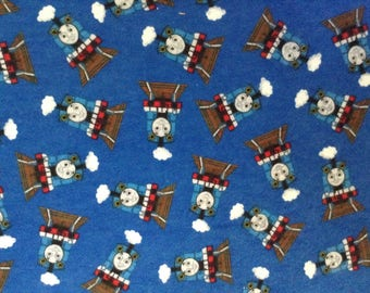 Flannel/Thomas Train on blue background cotton fabric by the yard