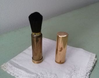 Makeup brush with baton/stick retractable brass as a lipstick