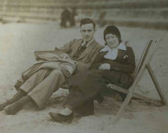 C1930s vintage black and white photo of attractive young couple on the beach