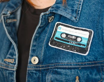 Embroidered brooch Audiocassette (a tape)
