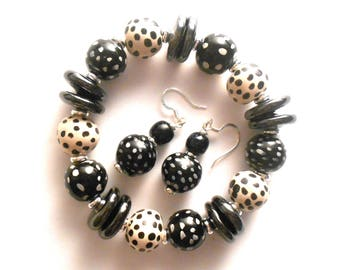 Matching Kazuri fair trade ceramic bracelet and ear rings in cream and black.
