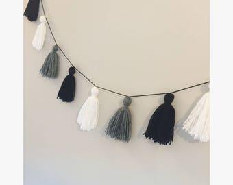 Monochrome yarn tassel garland