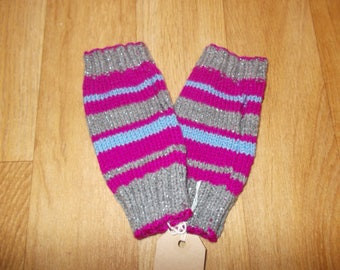 Hand knitted wrist warmers.