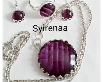 Set of purple pendant, ring and earrings