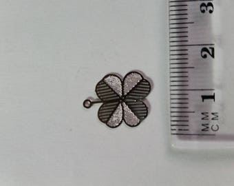 "Filigree silver metal ""clover"" charm"