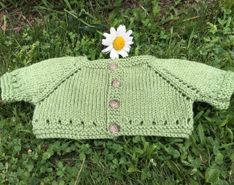 Baby shrug in green, ages newborn to 12 months