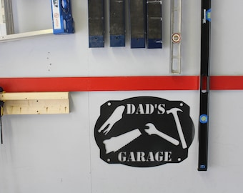 Dad's Garage Metal sign with tool Silhouette