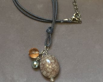 Stone pendant and bead accent cord necklace