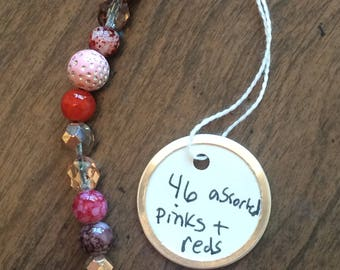 46 Assorted Pinks and Reds, Plastics, Wood and Glass Beads
