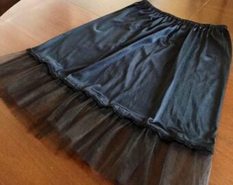 Vintage black slip customized with a black net finish