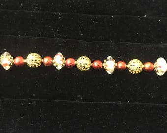 Beaded red and gold bracelet