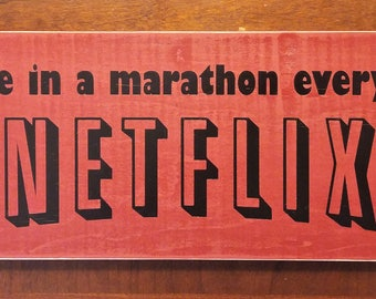 I participate in a marathon every weekend...a Netflix marathon wooden sign