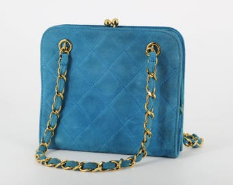 Vintage Chanel turquoise suede bag