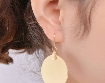 Stunningly simple gold disc drop earrings