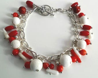 Bracelate with white and red coral beads