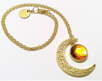 Gold-plated necklace with glass-cut amber pendant