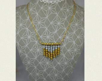 Necklace cascade of silver and golden pearls