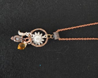 Sun and moon, in mixed metals