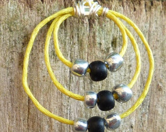 Yellow linen and black beads earrings