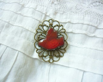 small red tribal bird brooch Red