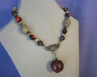 Coconut seeds, buri and caconnier donkey Eye necklace