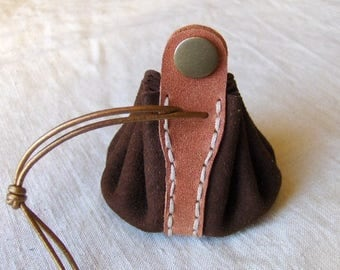 Coin purse is orange-brown leather hand stitched