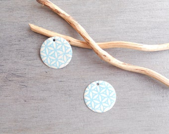 2 light turquoise and ivory sequins (one side pattern and a solid)