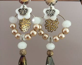 very pretty earrings with mother of pearl beads