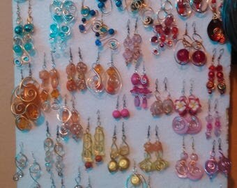 A lot of earrings of all colors and sizes.