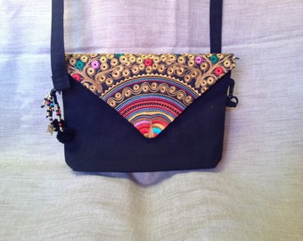 Little black bag with flap in Thai embroidery.