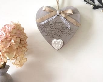 "Fretwork wood heart painted in taupe, holder of a stamped message ""Love"""