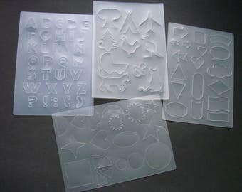 Set of 4 sheets of stencil letters and shapes