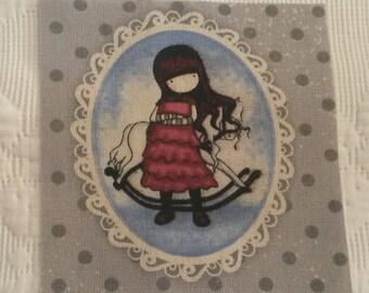 Little vignette of vintage fabric / little girl / printing on fabric