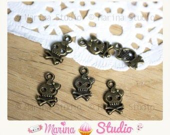10 charms skull with bow type kawaii bronze color, rare